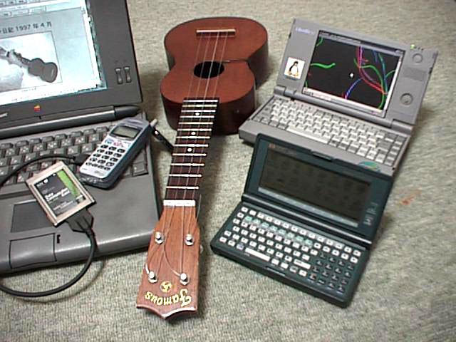 http://www.st.rim.or.jp/~kimu/ukulele/ukulele-and-palmtops-l.jpeg